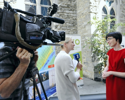Dr. ir. Margriet Drouillon, being interviewed by the press (© Geert Van de Wiele, UGent)